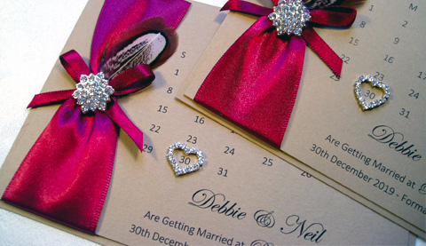 Rustic save the date card with red ribbon